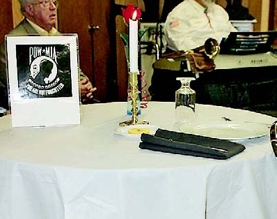 A table for one was set for those POWs and MIAs not able to attend the annual Veterans Day service held at the Disable American Veterans building near Toledo Town.