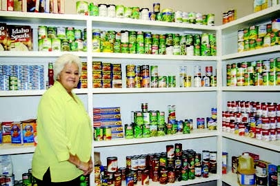 Beverly Sumner of the Sabine Council on Aging at Legacy House is shown with some of the staples in the food pantry.
