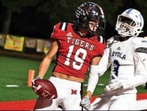 Loyola Flyers no match for mighty Tigers