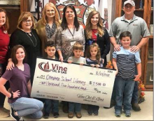 Vine Oil donates to Converse High School Library