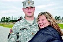 Proud mother, Tina McCormic of Many, congratulates her son after he was promoted to Major Timothy Adam McCormic in ceremonies at Camp Shelby, Miss. on Oct. 26.