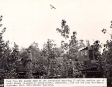 Grasshopper observation plane flying over Mt. Carmel during the large scale maneuver battle at that location in 1941.