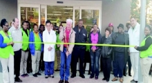 "Mayor G.J. ""Pie"" Martinez cuts the ribbon to declare the new Walmart Neighborhood Market open to the public on Jan. 21. He is surrounded by Walmart employees, town council members, and Police Chief Daniel Thoma"